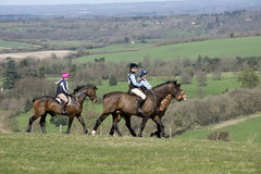 Horse riders in English countryside UK. Riders taking part in the Kingsclere Fun Ride at Whitehill in the high northern Hampshire countryside England UK Stock Image