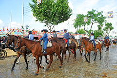 Horse riders at the Sevilla Fair, Spain. Men and children riding during the feast that is celebrated in spring in Seville, Andalusia, Spain Stock Images