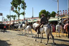 Horse riders at the Sevilla Fair, Spain Stock Images