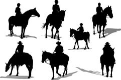 Horse riders silhouettes Stock Images