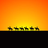 Horse riders silhouettes at sunrise. Horse riders black silhouettes at sunrise Stock Image
