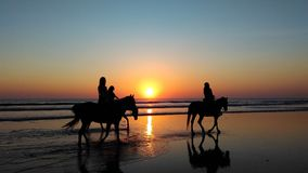 Horse riders at sunset Royalty Free Stock Photos