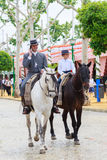 Horse riders taking a walk by the fair of Seville Royalty Free Stock Photo