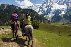Horse riders, tourists in Kashmir valley Royalty Free Stock Photos