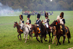 Horse riders wearing fur hats at Borodino battle historical reenactment in Russia Stock Image