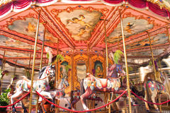 Horse rides on a merry-go-round carousel Royalty Free Stock Image