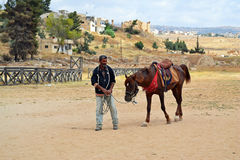 Horse Rides. One of the local vendors offering horse rides to the tourists within the ancient city ruins of Jerash royalty free stock image