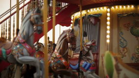 Horse rides on vintage merry-go-round carousel at fair. Horse rides on merry-go-round carousel at fair stock video