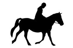 Horse Riding. Isolated silhouette of rider on horse back Stock Photo