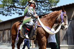 Horse riding. The man ride a horse with traditional armor in cherry blossoms festival of Kyoto, JAPAN Royalty Free Stock Photography