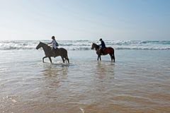 Horse riding at the beach at the ocean Stock Photo