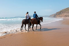 Horse riding at the beach at the ocean Royalty Free Stock Images
