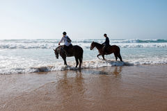 Horse riding at the beach at the ocean Royalty Free Stock Photo
