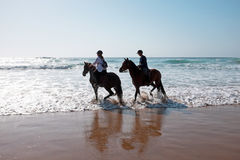 Horse riding at the beach at the ocean Stock Image