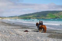 Horse riding on beach Stock Photo
