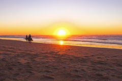 Horse riding on the beach Stock Photography