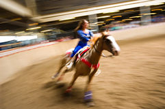 Horse riding competition. (Showing Fast Motion Royalty Free Stock Images