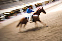Horse riding competition. (Showing strong sense of motion). Rider is not recognizable Royalty Free Stock Image