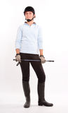 Horse riding gear. Isolated image of a teenage girl dressed in horse riding clothes Stock Photography