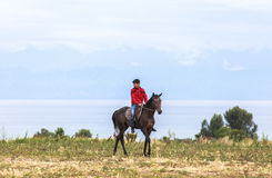 Horse Riding in Kyrgyzstan Stock Image