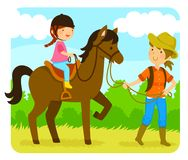 Horse riding lesson. Little girl riding a horse with an instructor Stock Images