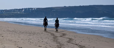 Horse riding on Perran Sands Stock Images