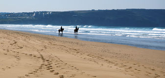 Horse riding on Perran Sands Stock Photo