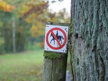 Horse riding prohibited or forbidden sign in black, white, red in forest near Berlin, Germany Royalty Free Stock Photos