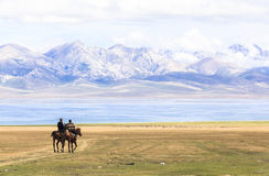 Horse Riding at Song Kul Lake in Kyrgyzstan royalty free stock photos