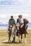 Horse Riding at Song Kul Lake in Kyrgyzstan Stock Images