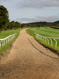 Horse riding track in Cotswold district of England. Horse riding stables for training race horses in Cotswold or Cotswolds district of southern England in the stock image