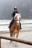 Horse riding in winter Royalty Free Stock Image