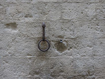 Horse-ring on a stone wall Royalty Free Stock Photography