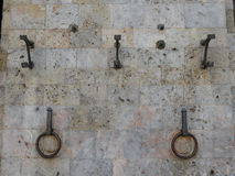 Horse-rings on a stone wall Royalty Free Stock Photography