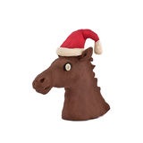 Horse's head in a cap of Santa Claus. Isolated on white background Royalty Free Stock Photo