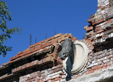 The horse's head on the wall of the destroyed building. Royalty Free Stock Image