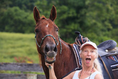 Horse Whinny and Surprised Senior Woman Royalty Free Stock Photo