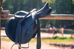 Horse saddle close up on stables fence Royalty Free Stock Image