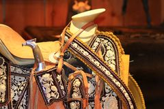 Horse Saddle with embroidery accents. Close up of horse saddle embelished with rose and floral embroidery accents Royalty Free Stock Photography