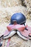 Horse saddle and helmet Royalty Free Stock Photo
