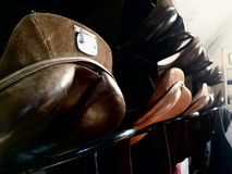 Horse saddles. Hanging up on wall in a stable Stock Photo