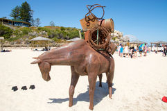 Horse Sculpture: Cottesloe Beach Event. COTTESLOE,WA,AUSTRALIA-MARCH 12,2016: Metal sculpture of horse carrying heavy load at the Sculptures by the Sea Royalty Free Stock Image