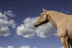 Horse sculpture. Park horse sculpture on cloudy sky background Royalty Free Stock Photo