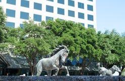 Horse sculpture in urban park. Outdoor sculpture of mustang horses running Stock Image