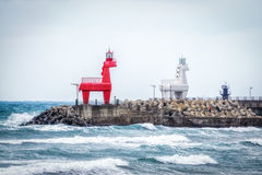 Horse shaped lighthouses. Iho Tewoo Beach two horse shaped lighthouses. Jeju Island, South Korea stock images