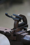 Horse Shoe in Anvil. Horse Shoe is clamped in the anvil Stock Photo