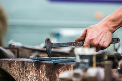 Horse shoe being crafted by blacksmith/farrier. A shot of a horseshoe being crafted by a skilled blacksmith/farrier. Fantastic concept shot. The photo was taken Royalty Free Stock Images