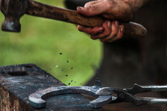 Horse shoe being crafted by blacksmith/farrier. A shot of a horseshoe being crafted by a skilled blacksmith/farrier. Fantastic concept shot. The photo was taken Stock Photography