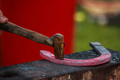 Horse shoe being crafted by blacksmith/farrier. A shot of a horseshoe being crafted by a skilled blacksmith/farrier. Fantastic concept shot. The photo was taken Royalty Free Stock Photos