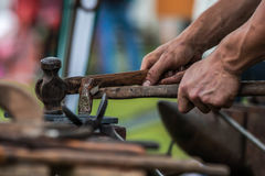 Horse shoe being crafted by blacksmith/farrier Stock Images